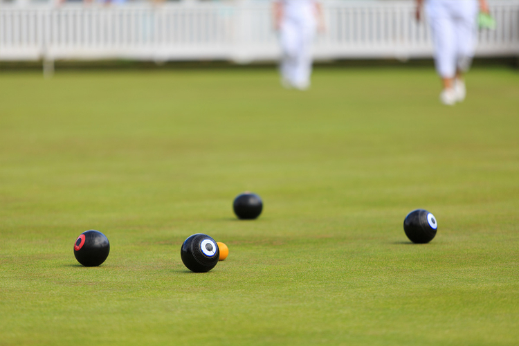 Close-up of bowls being played