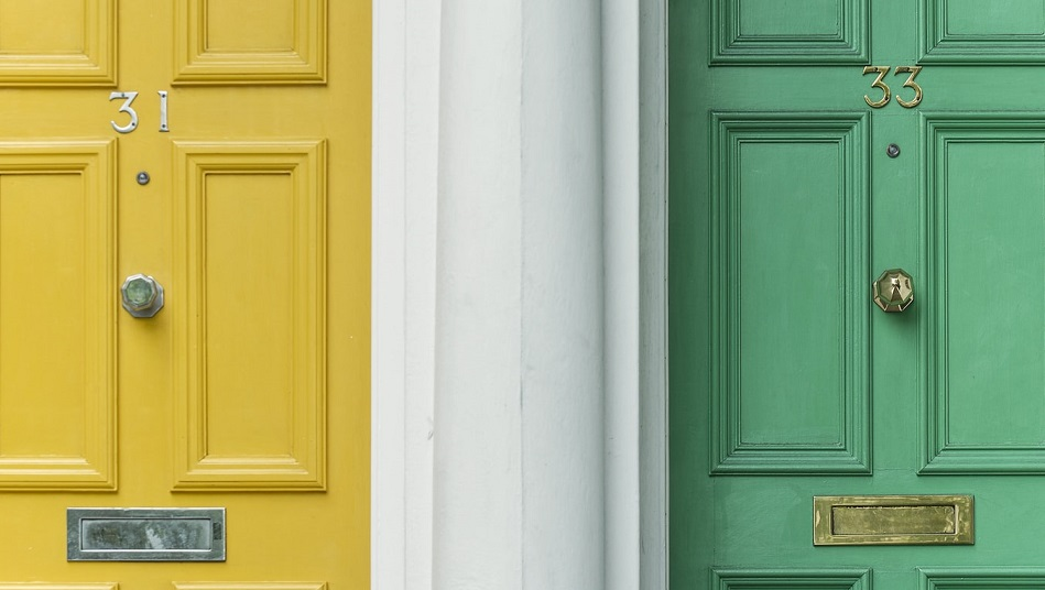 Picture of two front doors, yellow and green